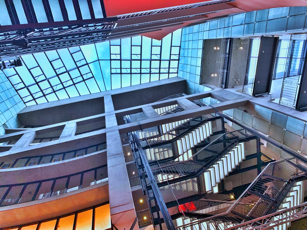 low-angle photography of building staircase during daytime
