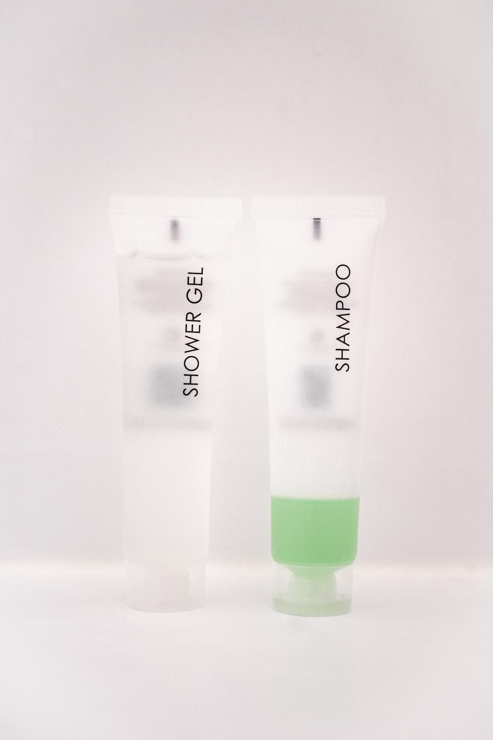 shower gel and shampoo soft-tube bottles on white surface