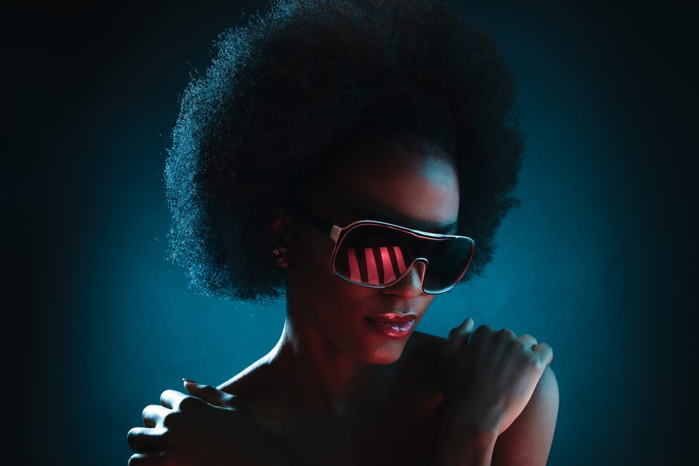 selective focus photography of woman wearing shield sunglasses
