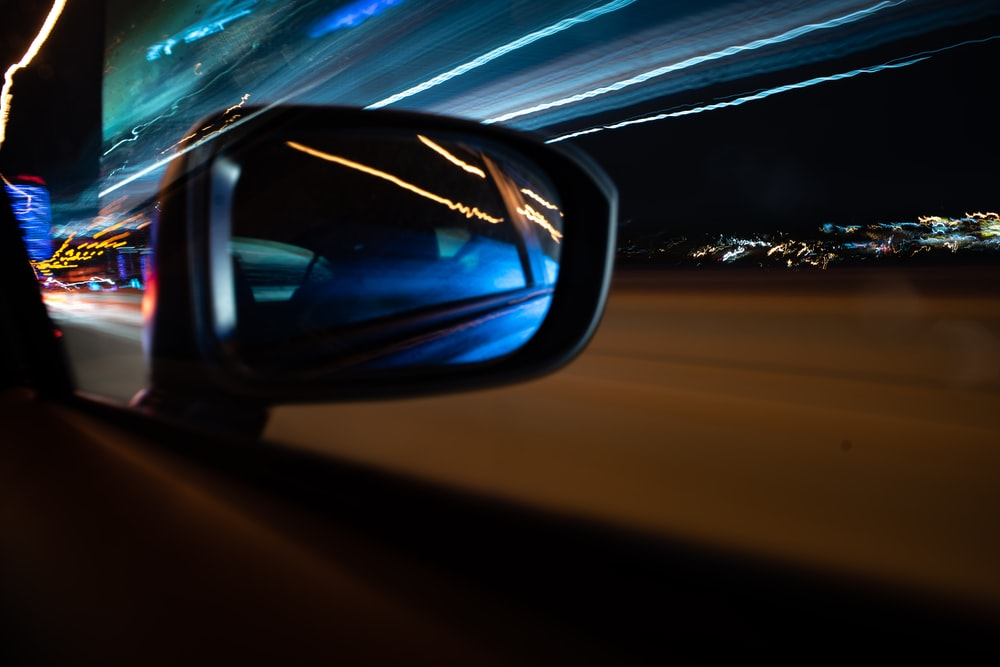 time lapse photography of vehicle side mirror