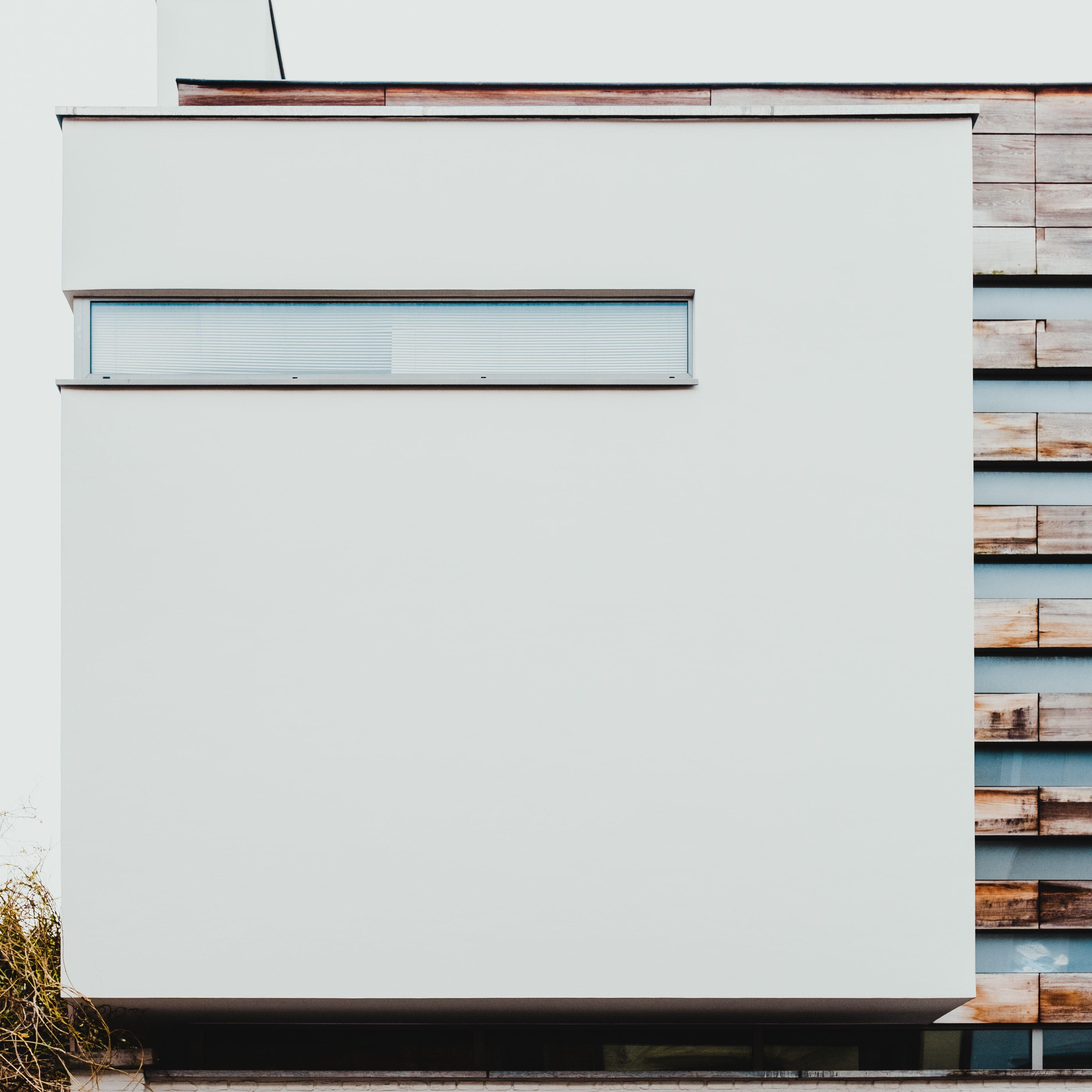 white and brown concrete building during daytime