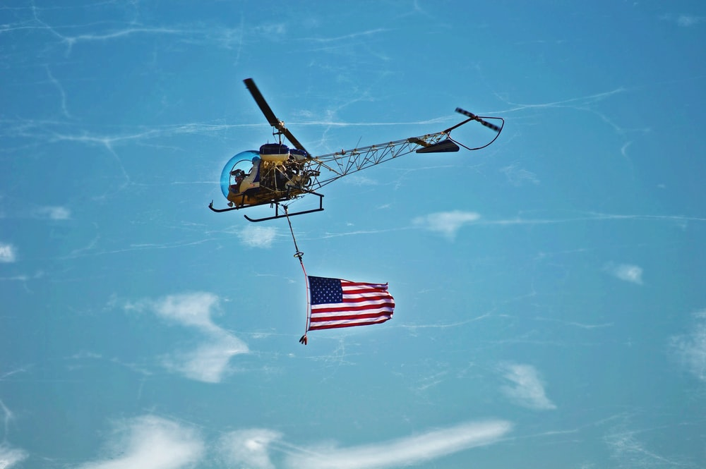 helicopter waiving flag of USA