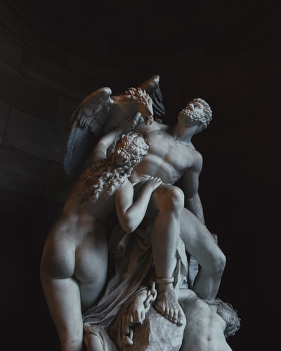 nude male and female with bird sculpture