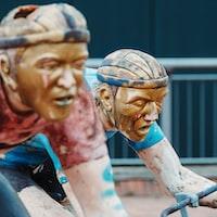 man riding bike statue