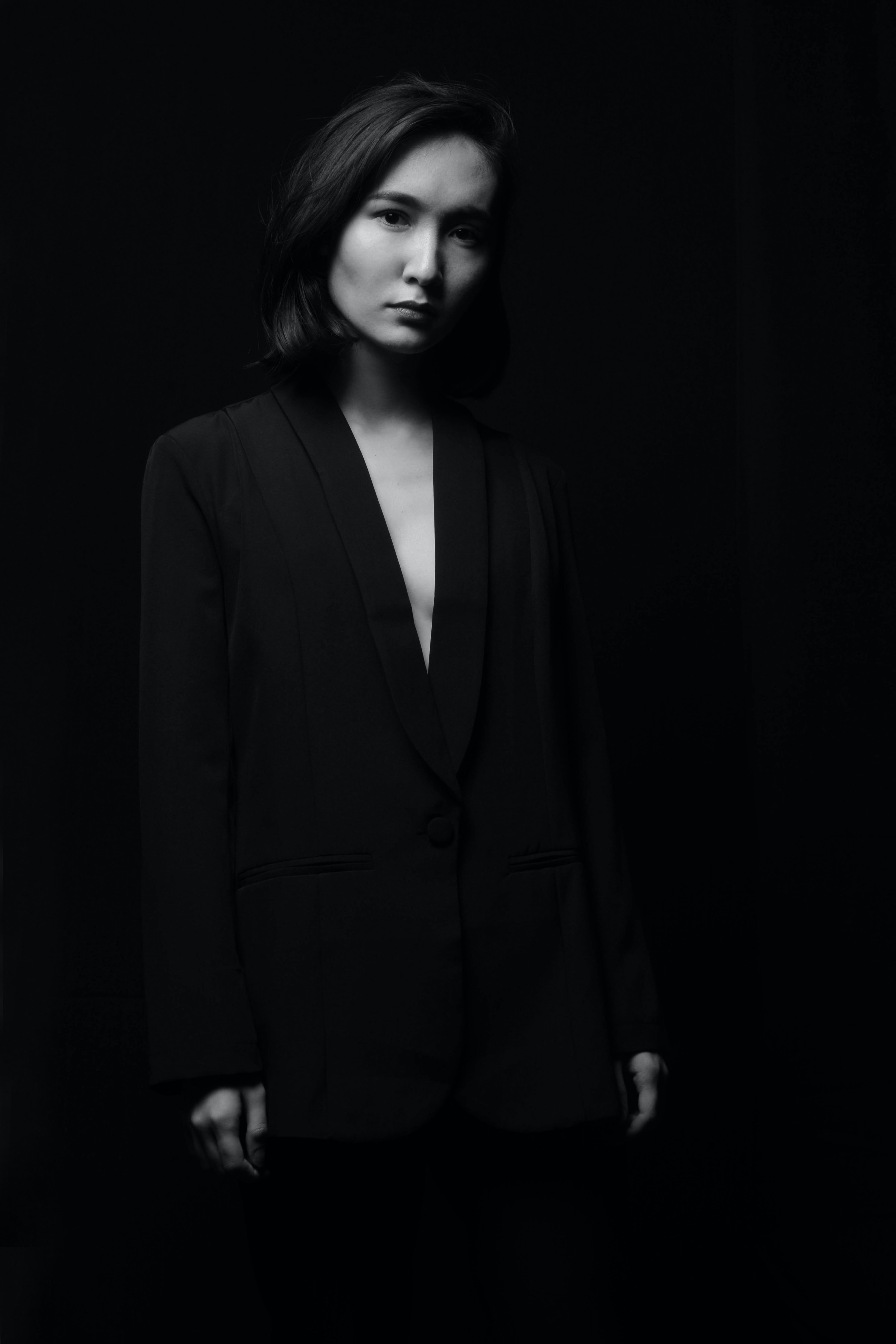 grayscale photo of woman wearing black suit