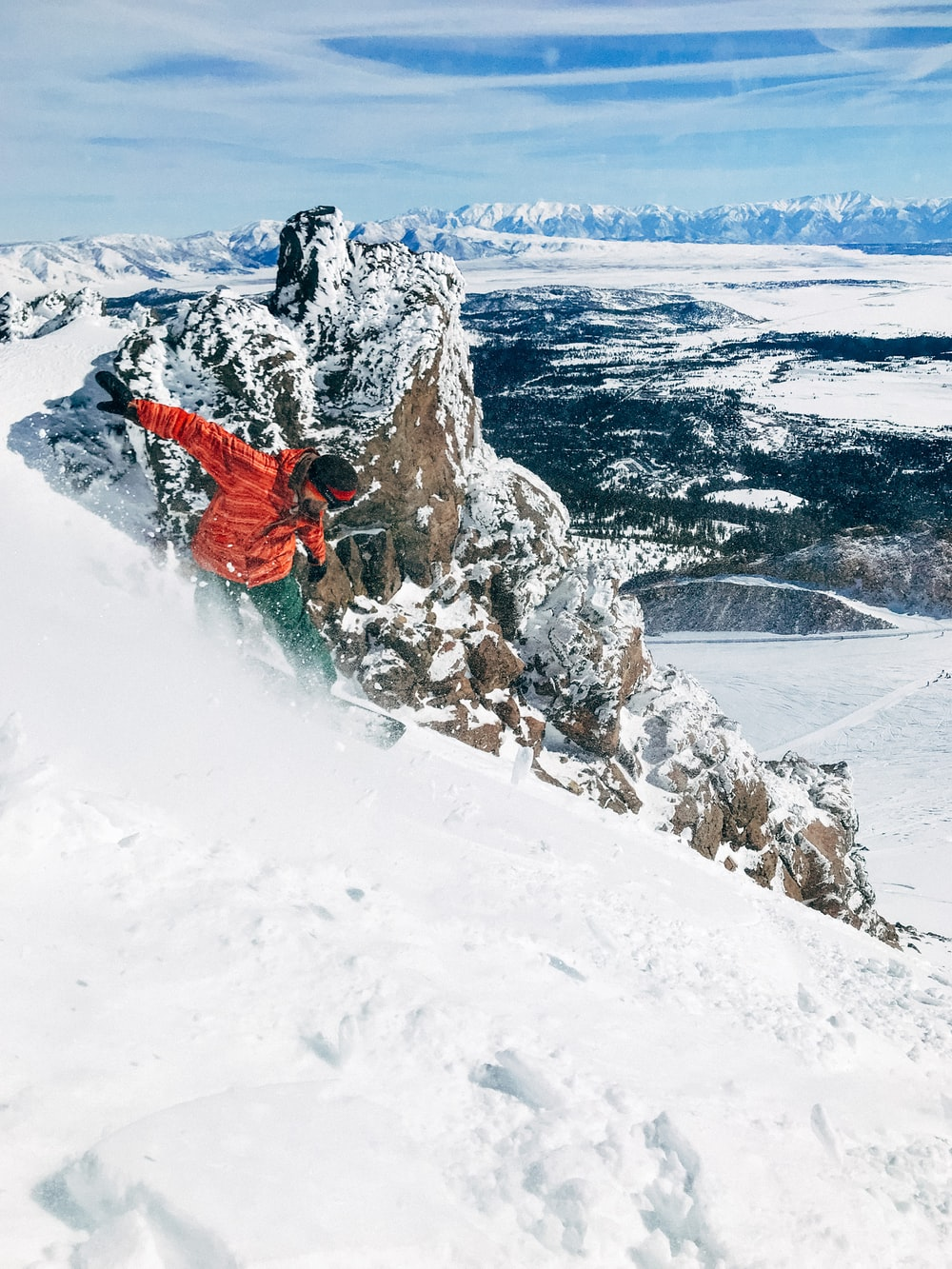 man snowboarding on mountain covered with ice