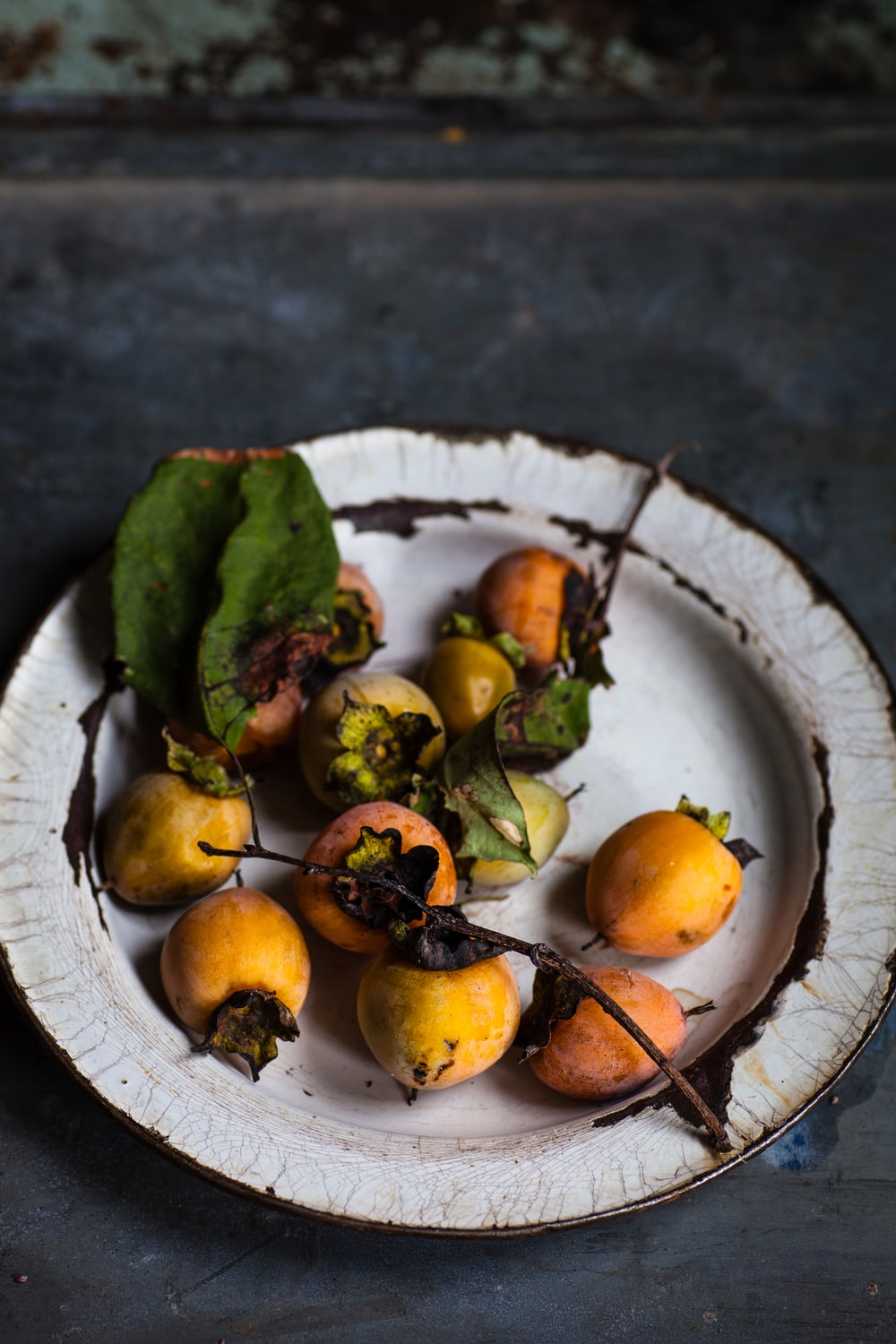 round yellow fruits on ceramic plate