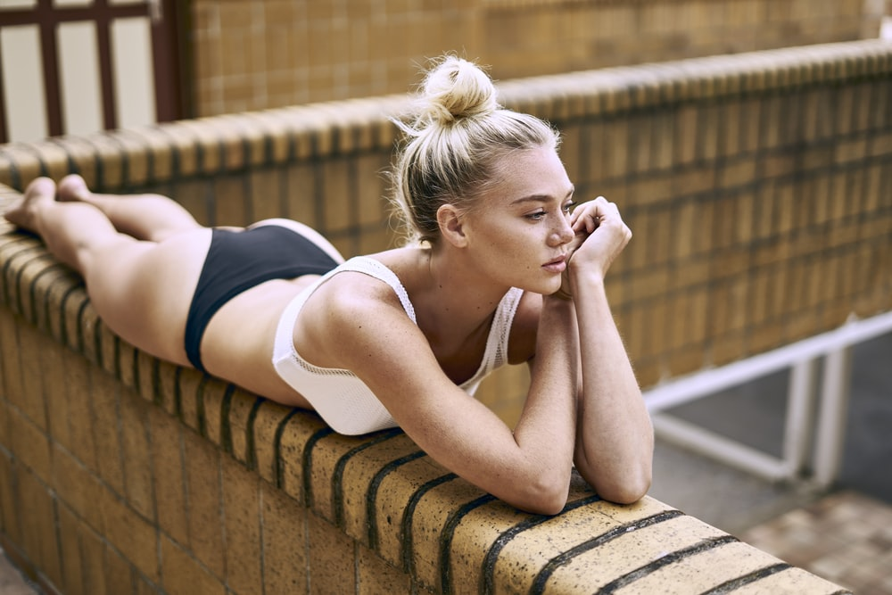 woman leaning on brown concrete rails