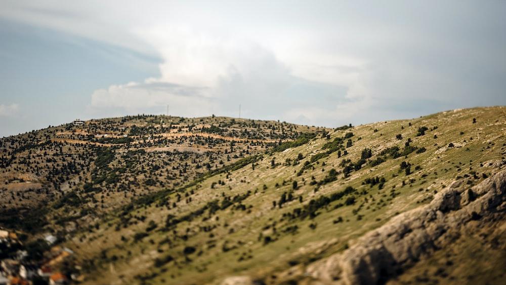 green mountain range under blue sky during daytime