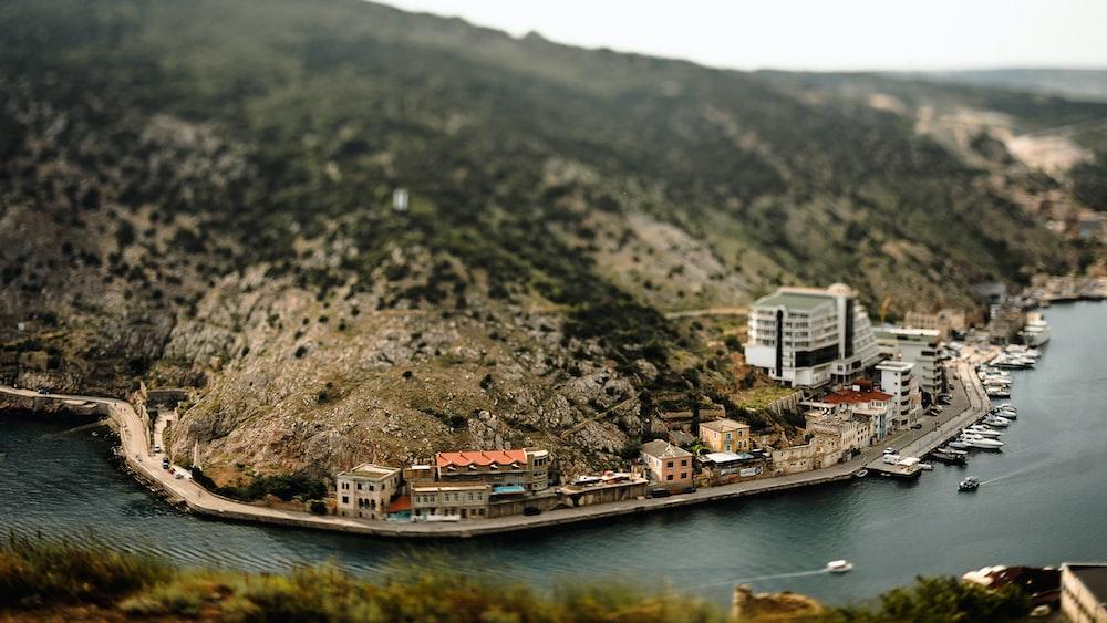 panoramic photo of village near body of water