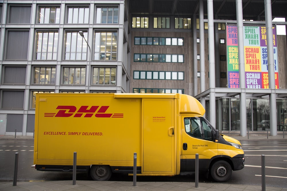 yellow DHL van parked
