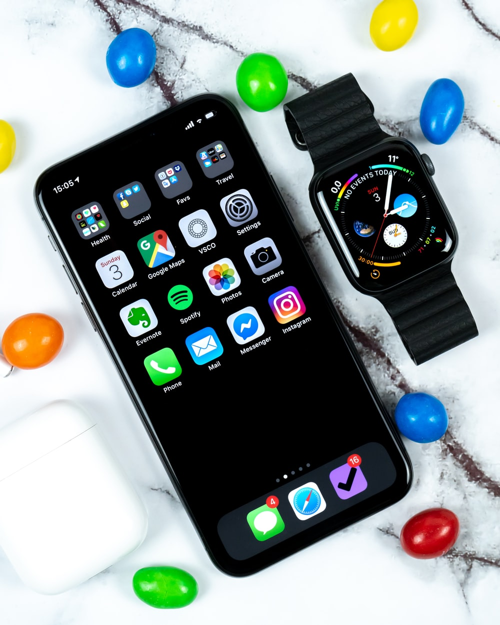 Apple watch beside iPhone