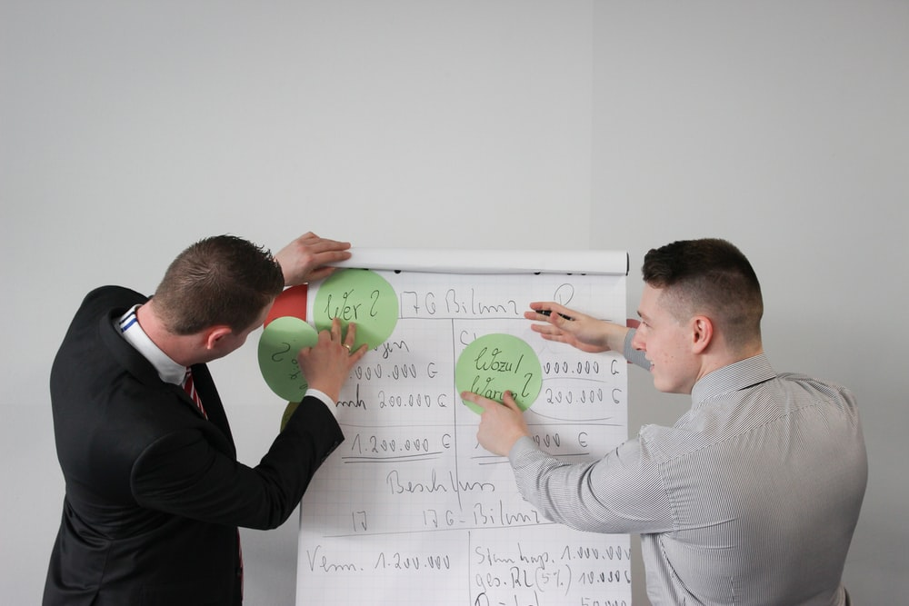 two men doing presentation visual aide