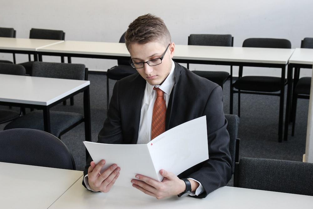 man holding folder in empty room