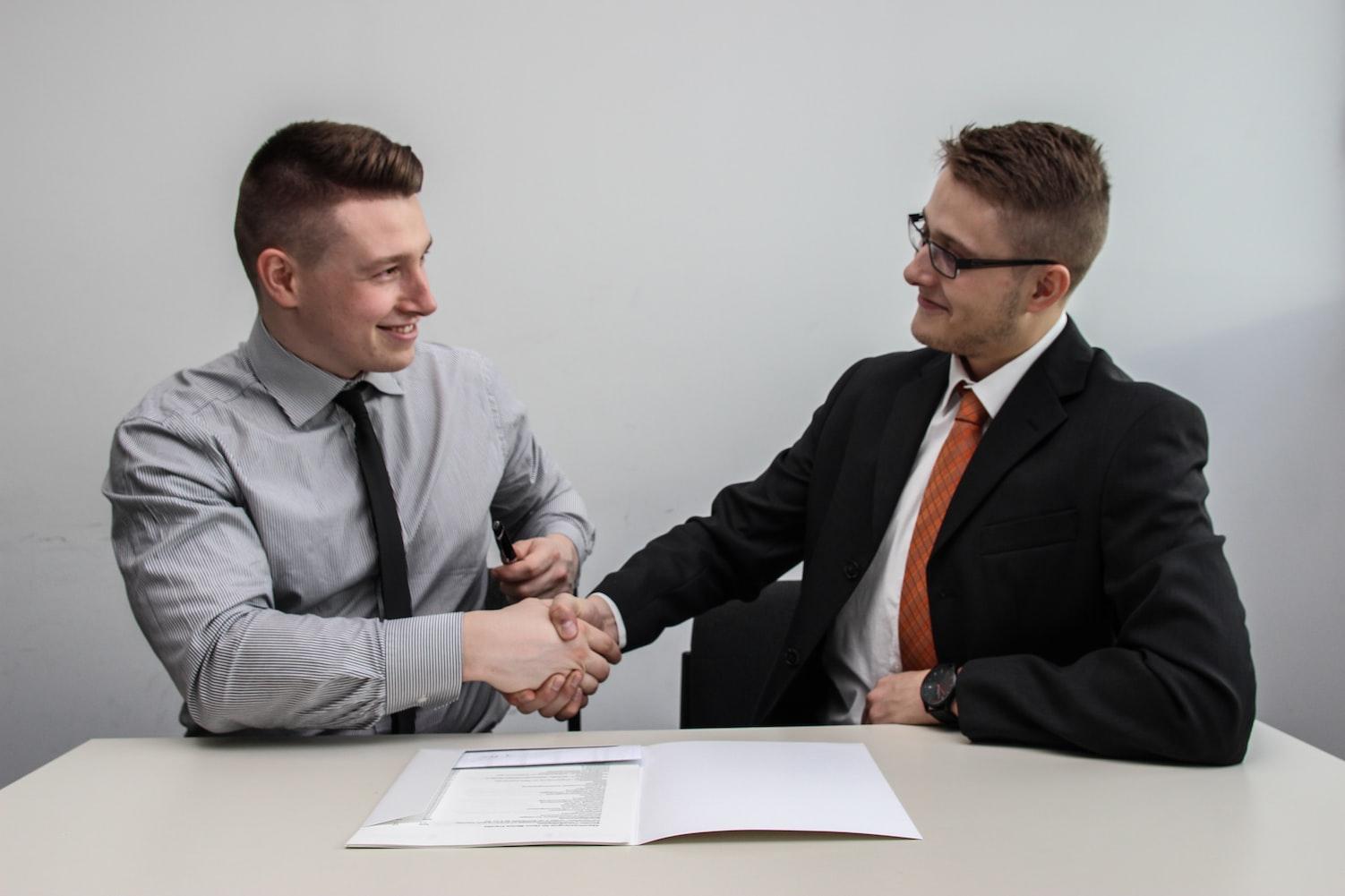 two men shacking hands