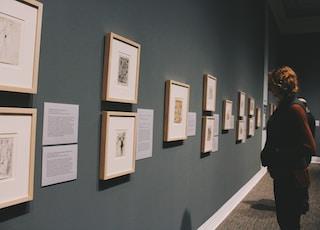 woman looking at wall frames