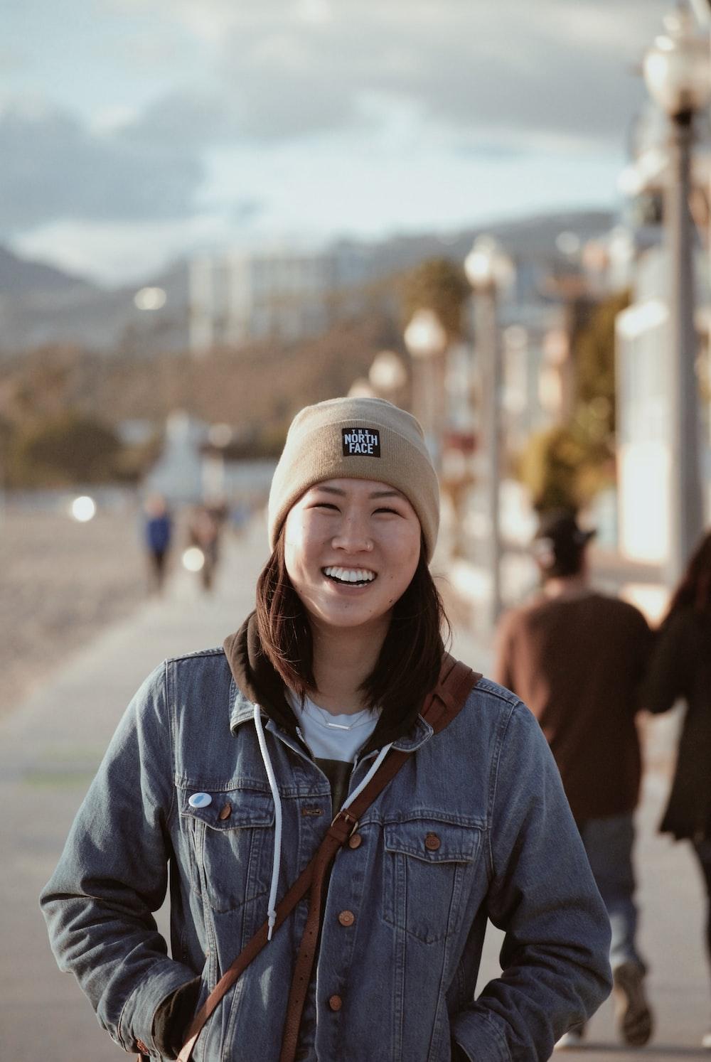 smiling woman wearing brown cap
