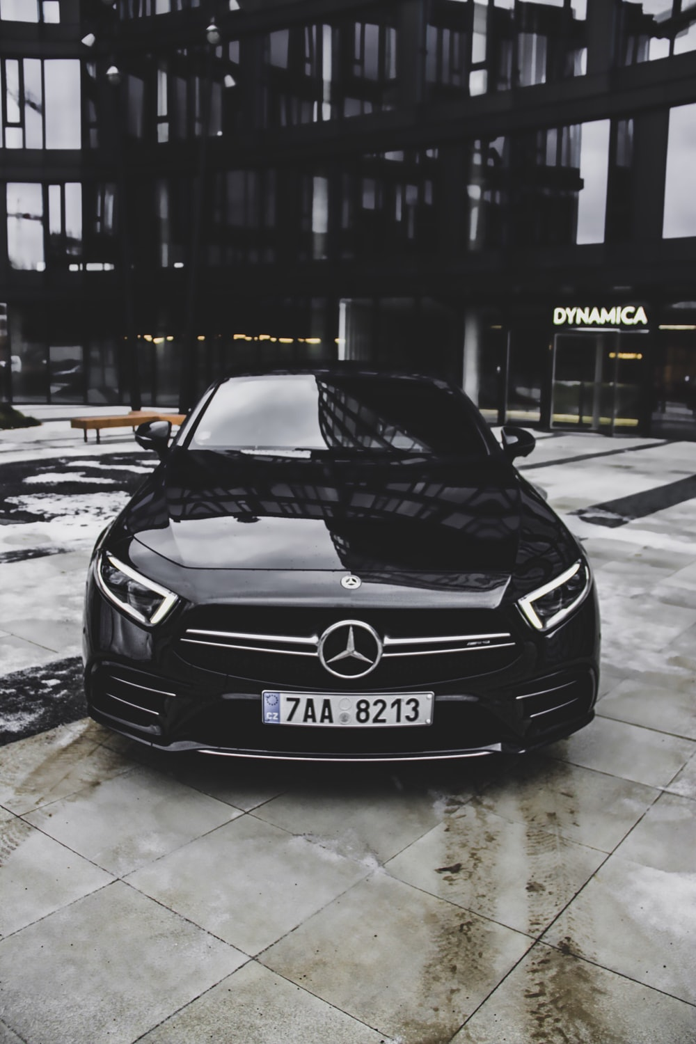 black Mercedes-Benz vehicle parked outside Dynamica building