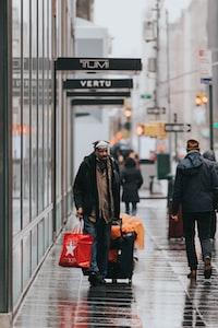 man pulling his travel luggage