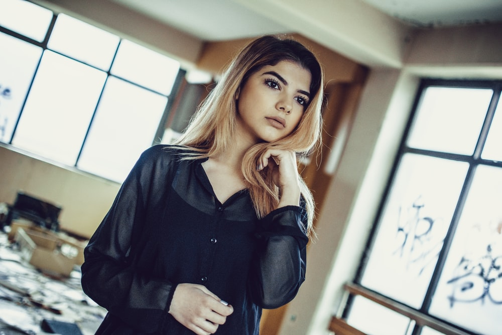 selective focus photography of woman in black long-sleeved shirt