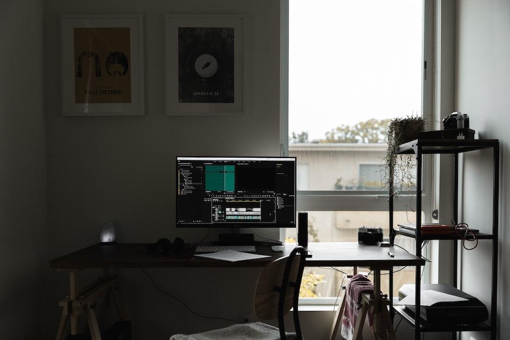 black flat screen monitor with screen turn on