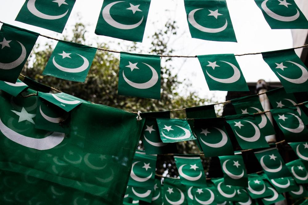 Flag of Pakistan raising on street