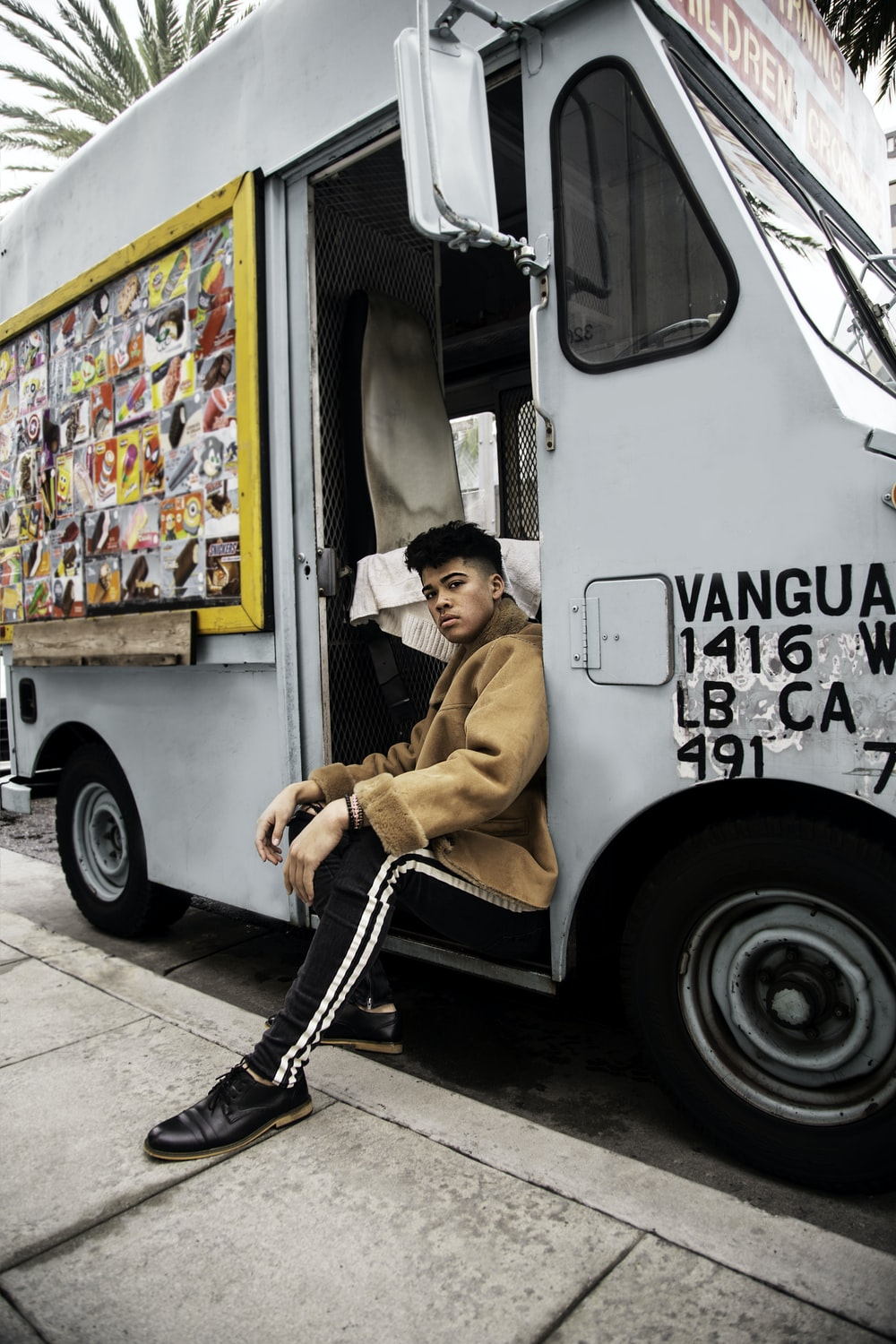 man sitting on white food truck
