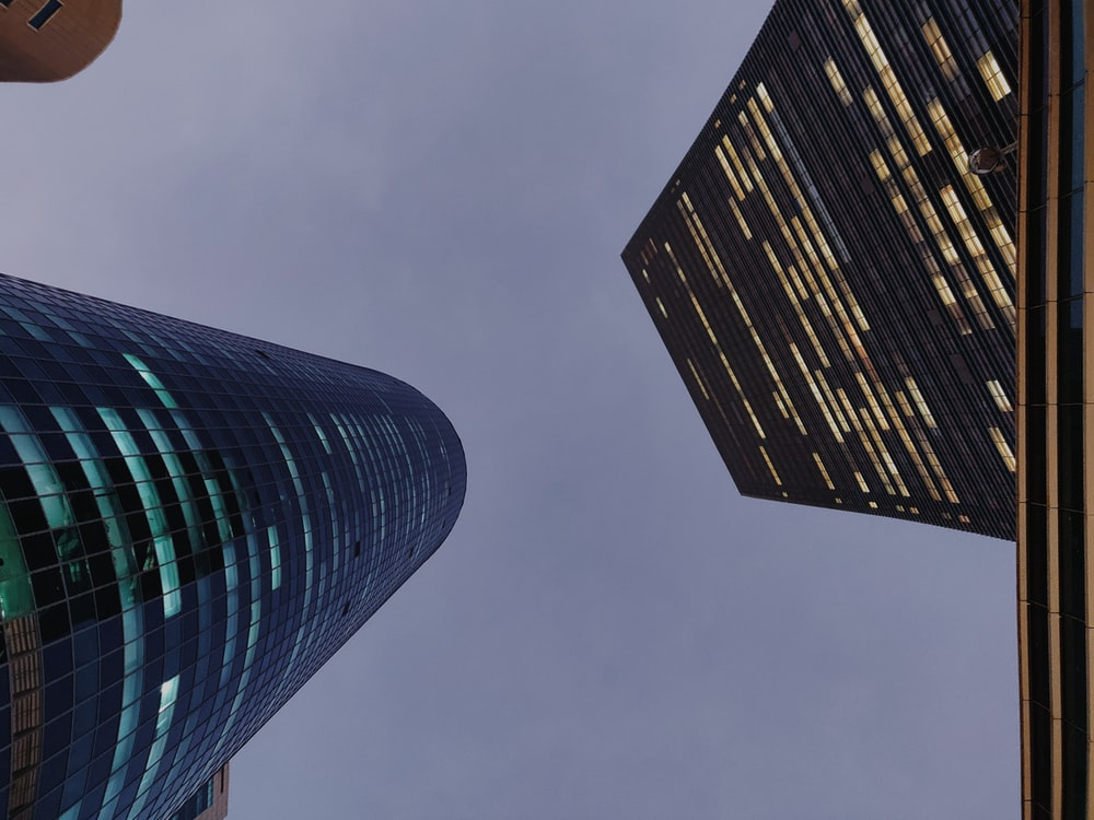 low-angle photograph of two high-rise buildings