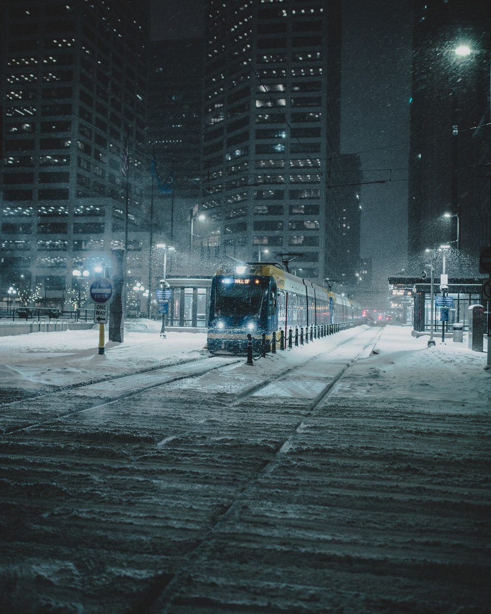 train on track at night during a snowy weather