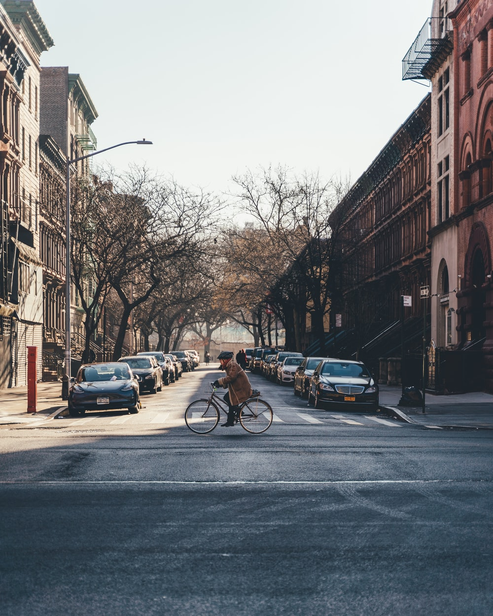 person riding bicycle at the middle of the street