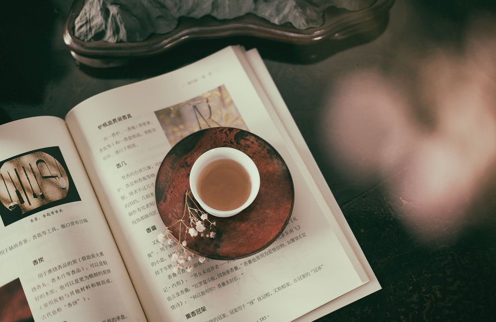 cup of coffee on book