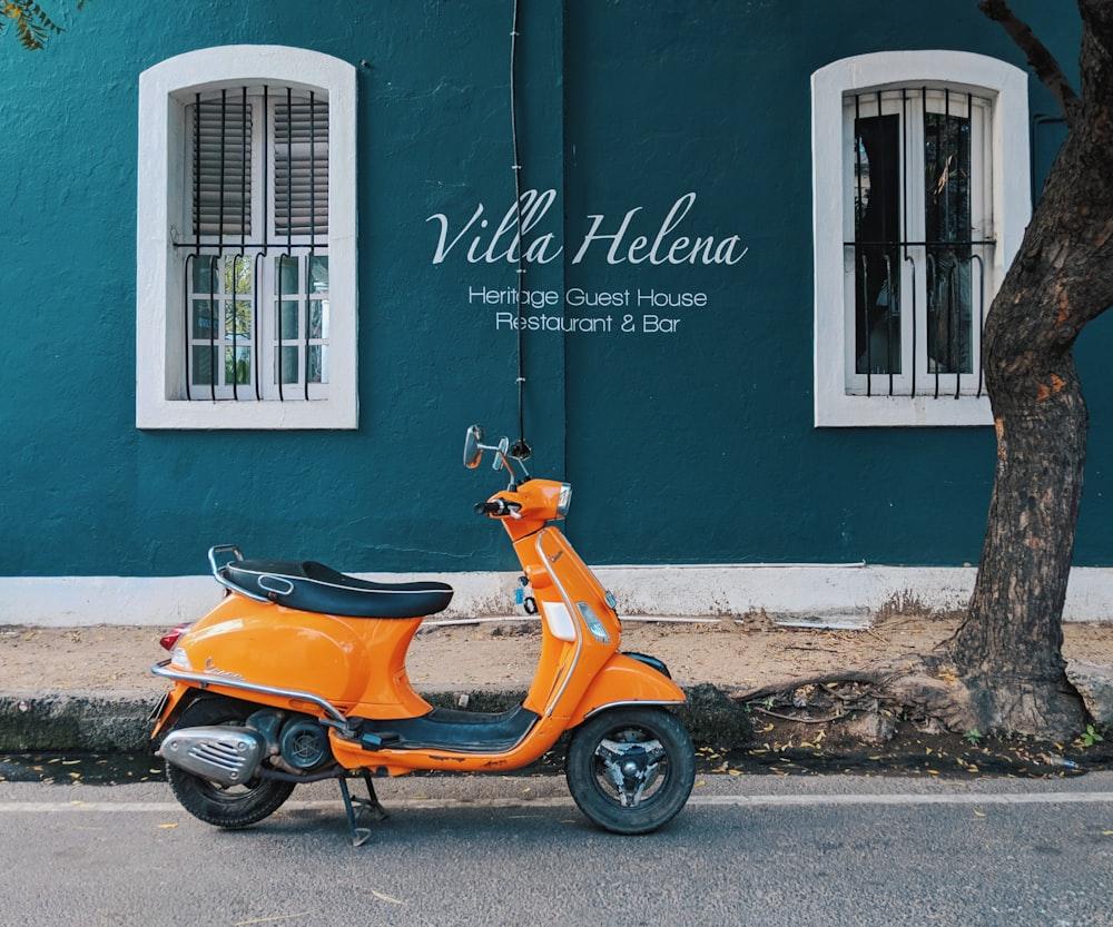 orange motor scooter park near Villa Helena Heritage Guest House building