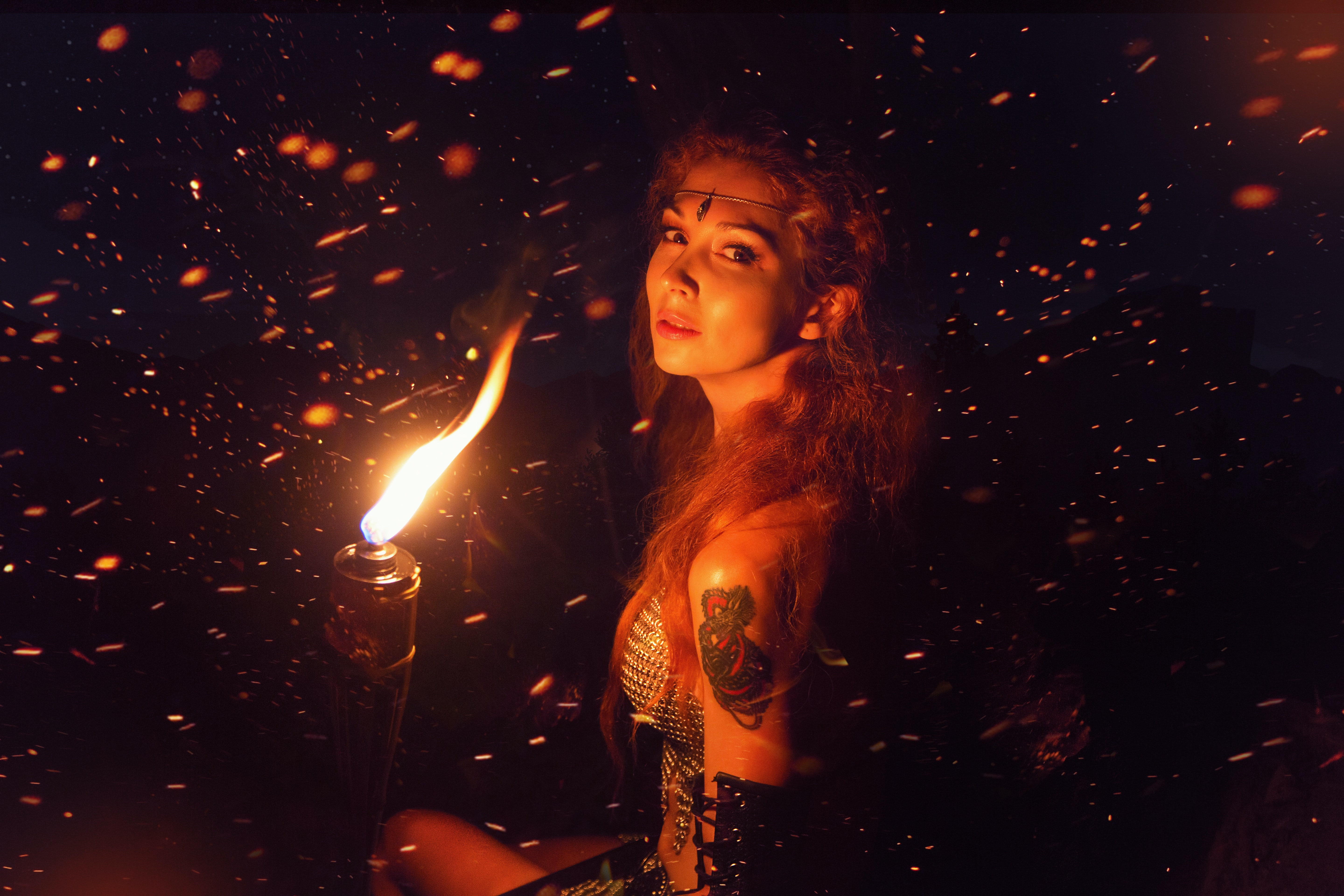 woman holding torch
