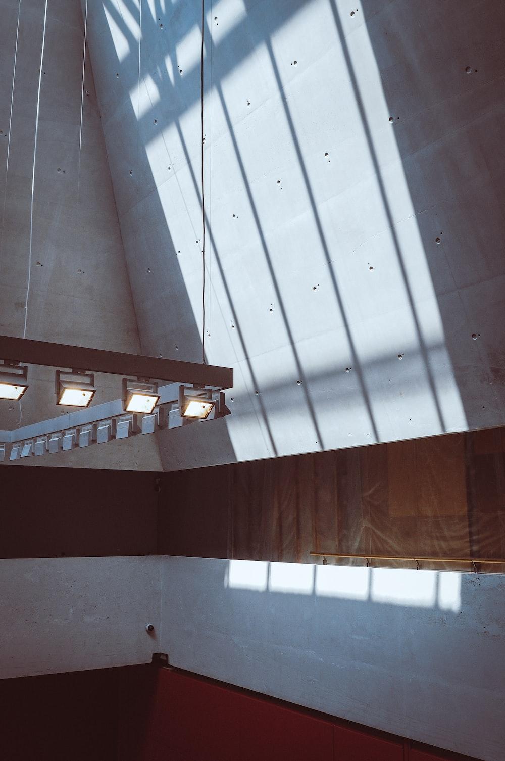 empty corner under lighted ceiling lamp