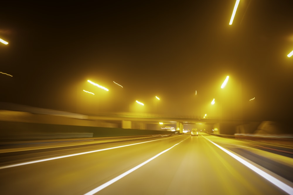 timelapse photography of vehicles on road at night