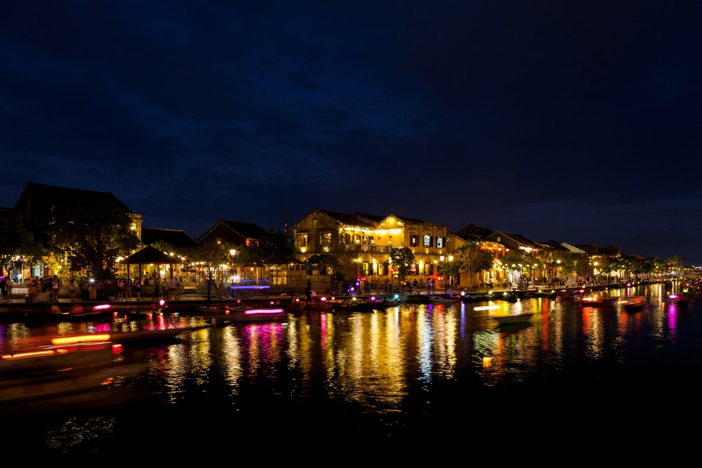 lighted houses near sea