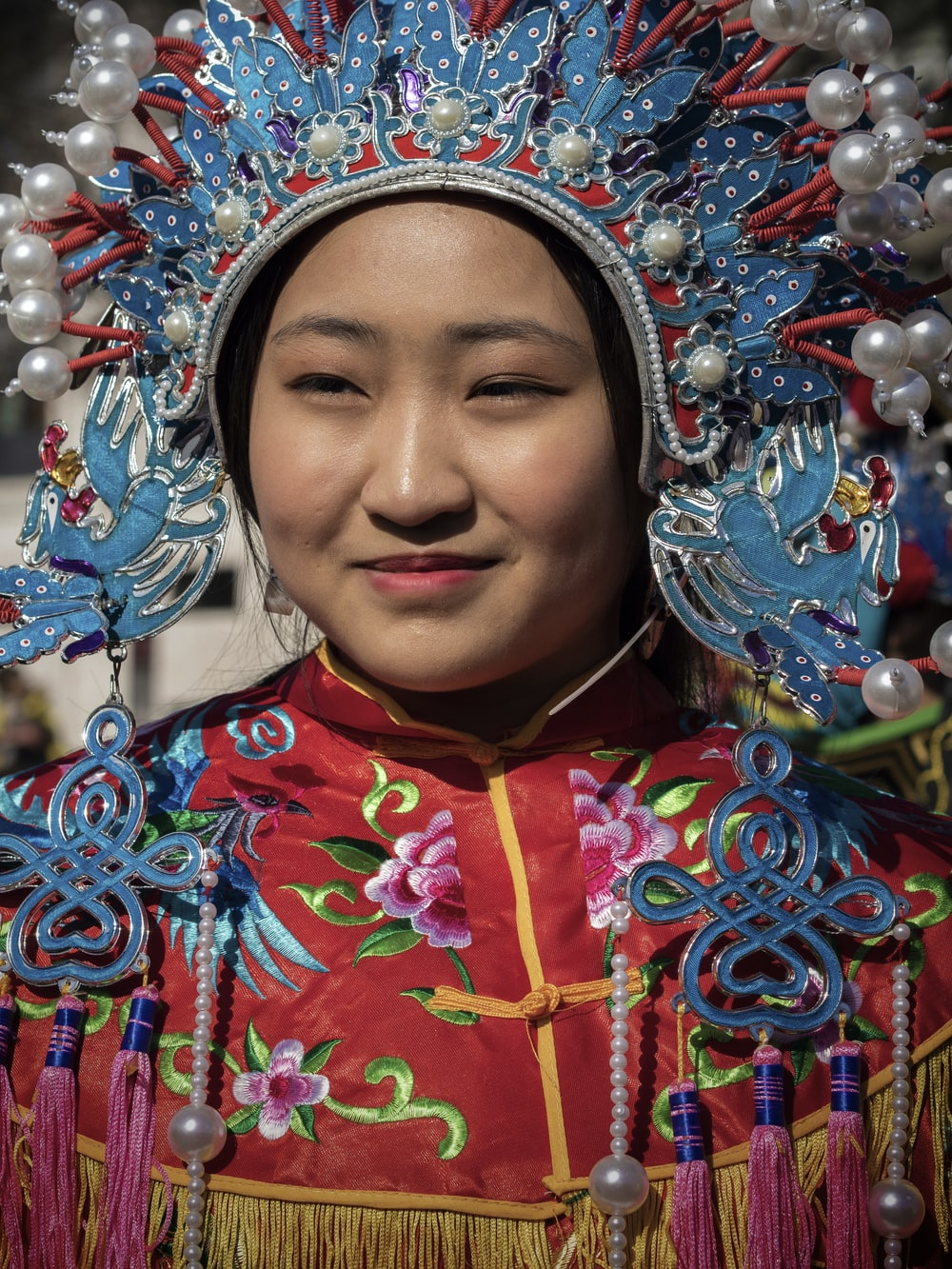 woman wearing blue and red head dress costume