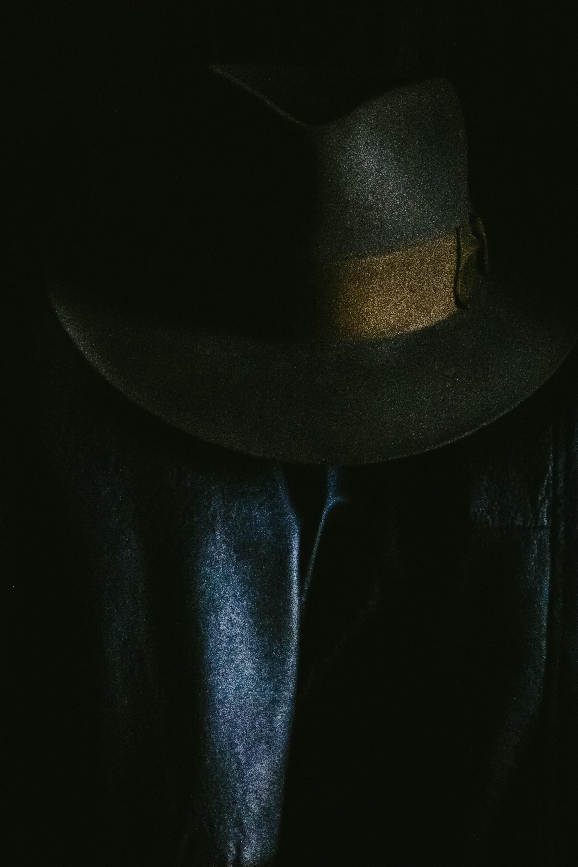 gray fedora hat on black textile