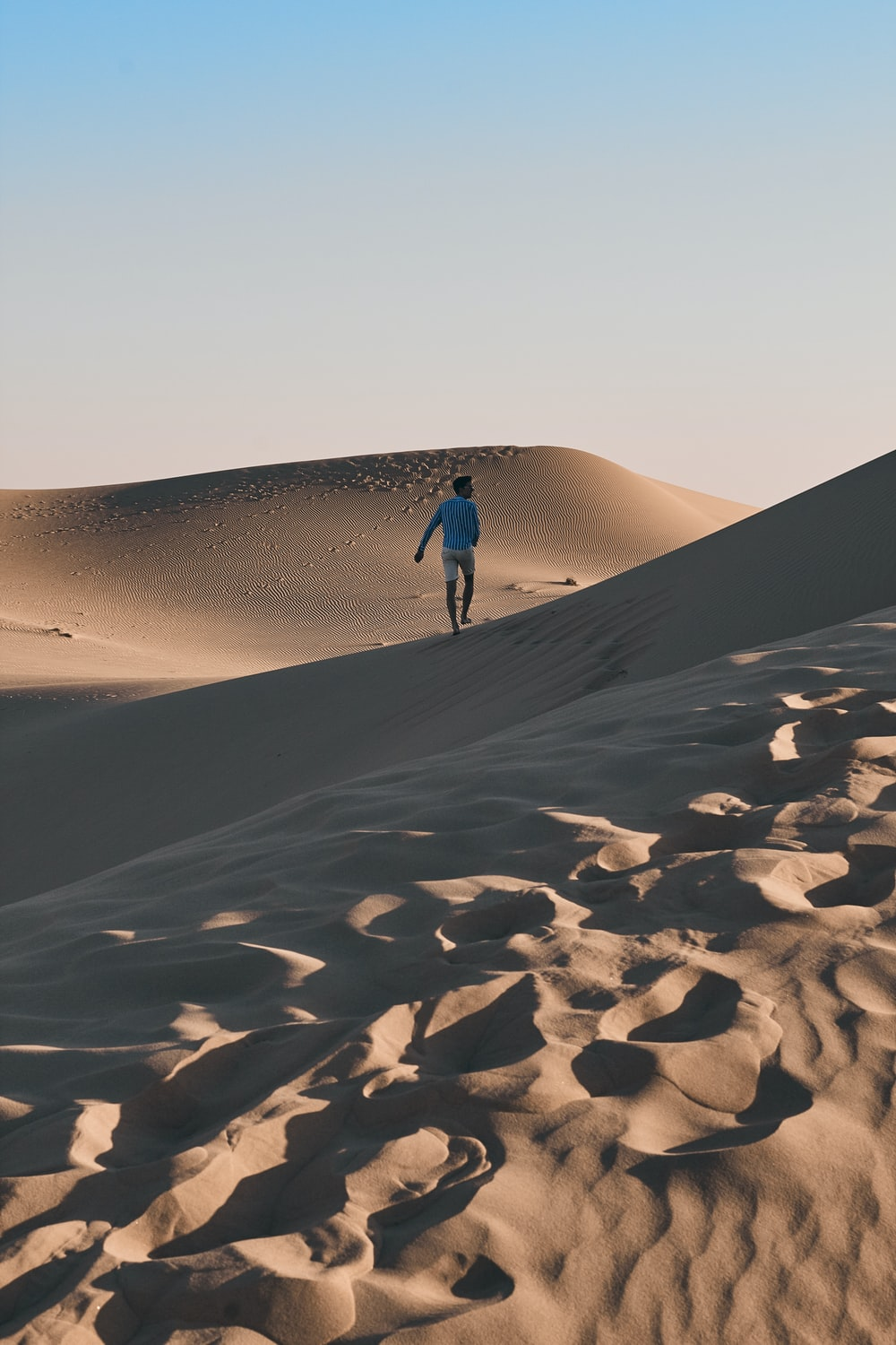 man walking alone on deserted place