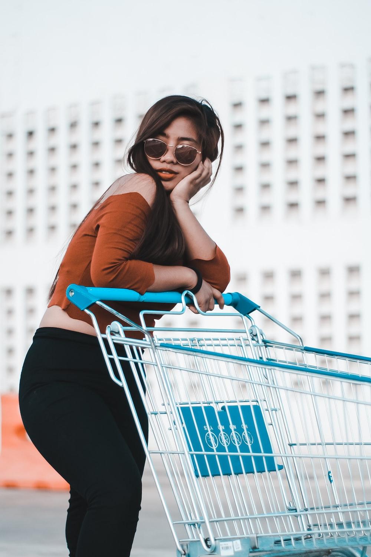 woman holding shopping cart during daytime