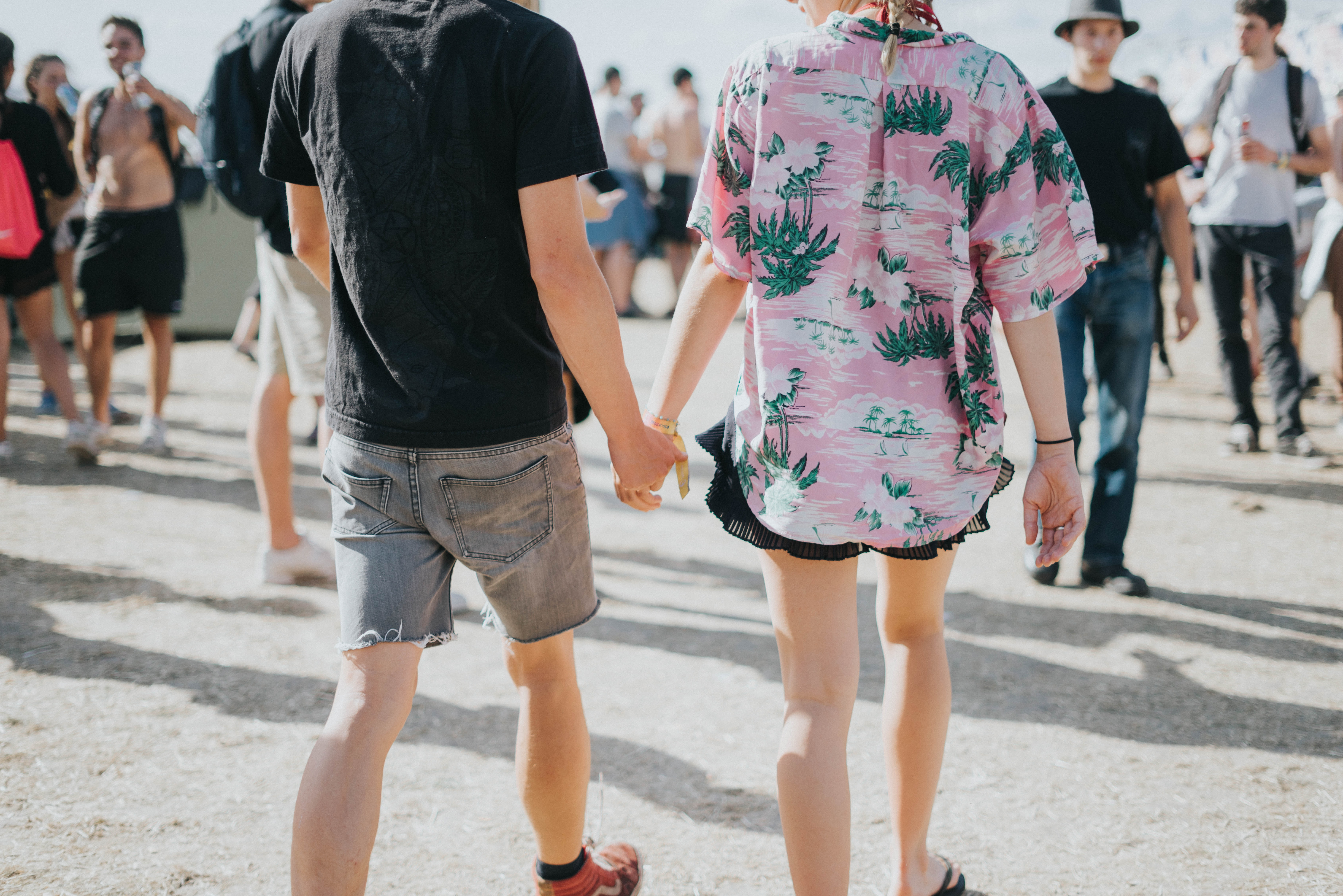 man and woman holding hands at middle of street