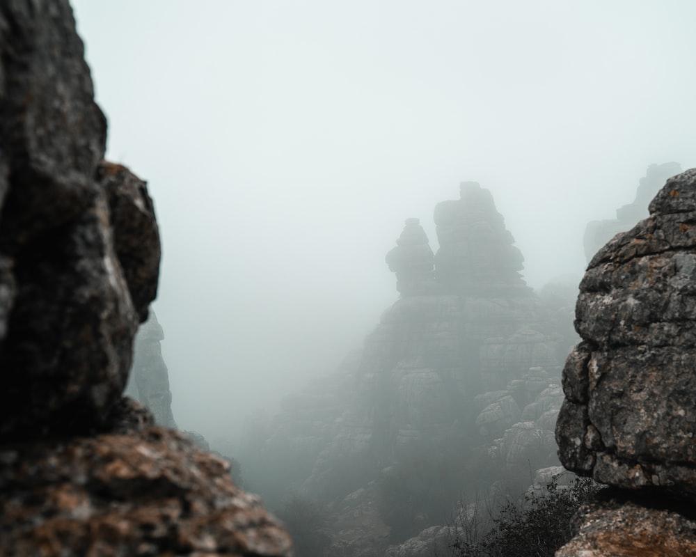 rocky mountain under foggy weather