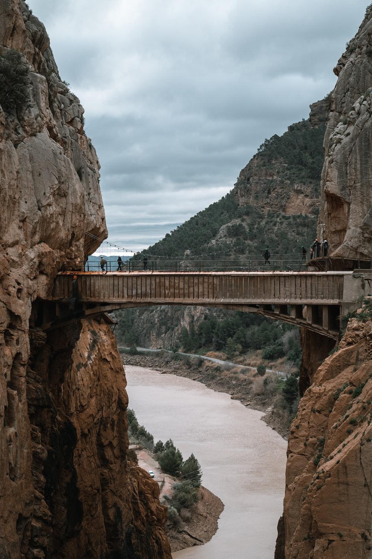 brown bridge between rock formation