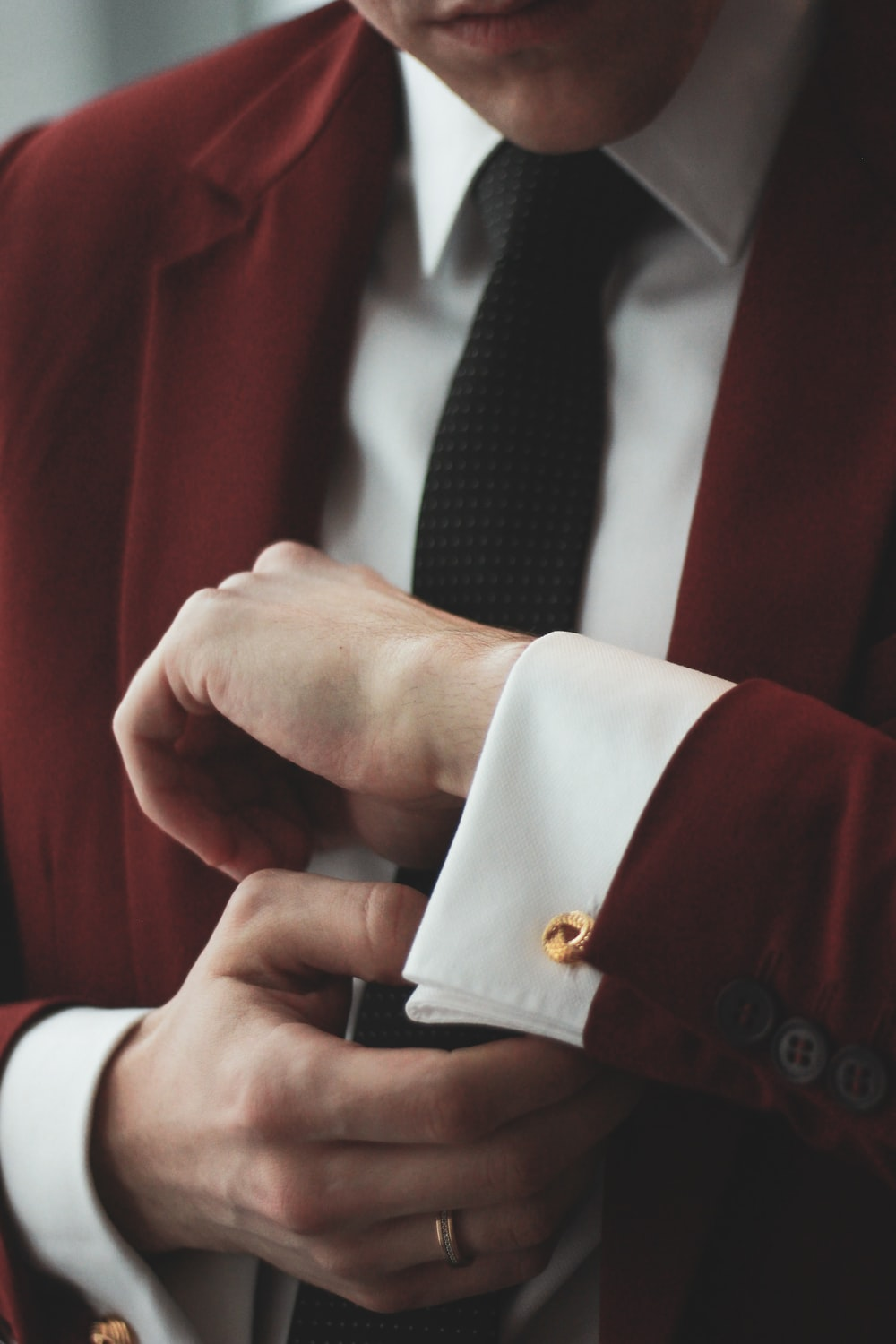 man wearing maroon and white dress suit