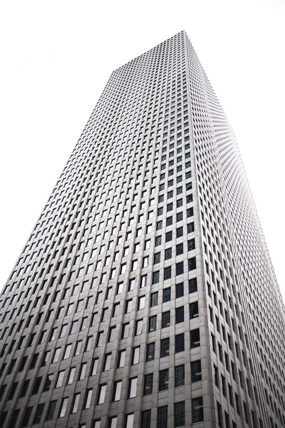 low-angle photography of gray high rise building
