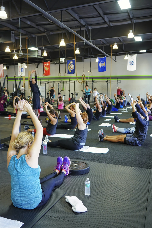 people doing yoga inside gym