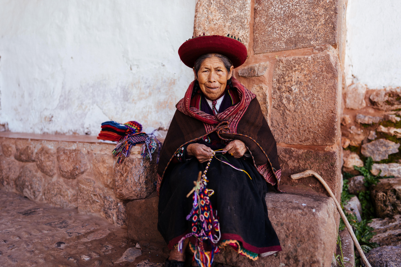 woman sitting on brown rock during daytime