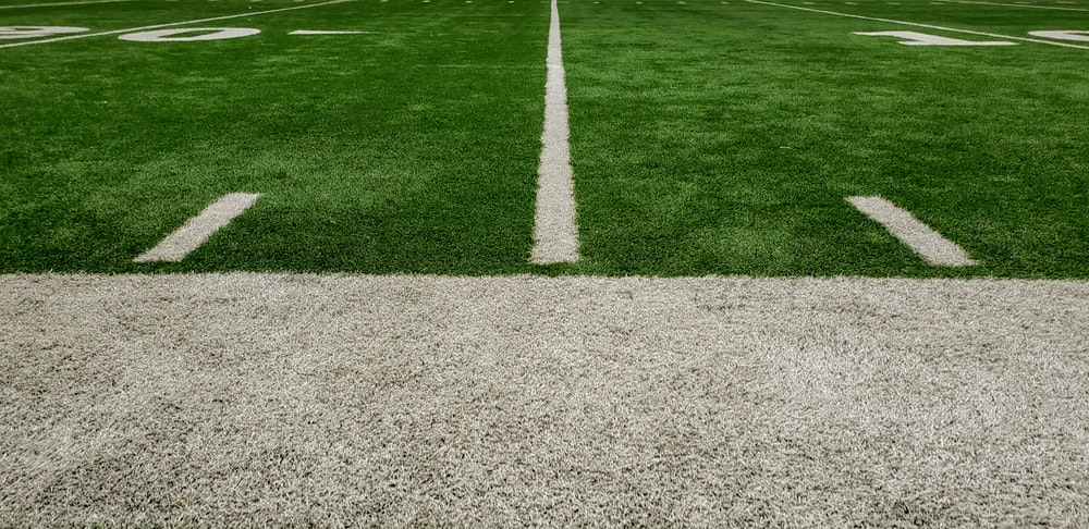 green and gray grass field