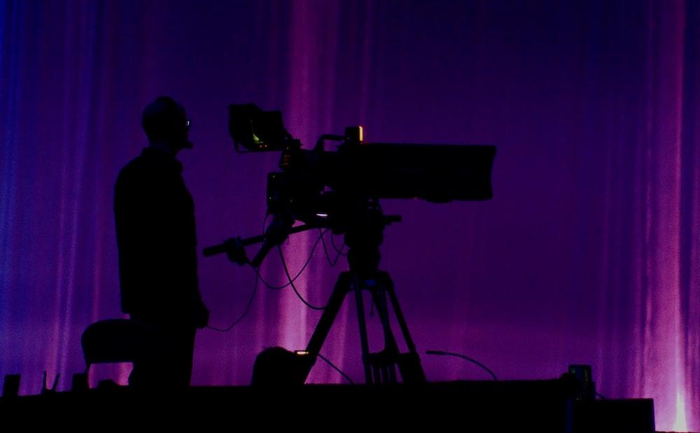 person standing near studio camera