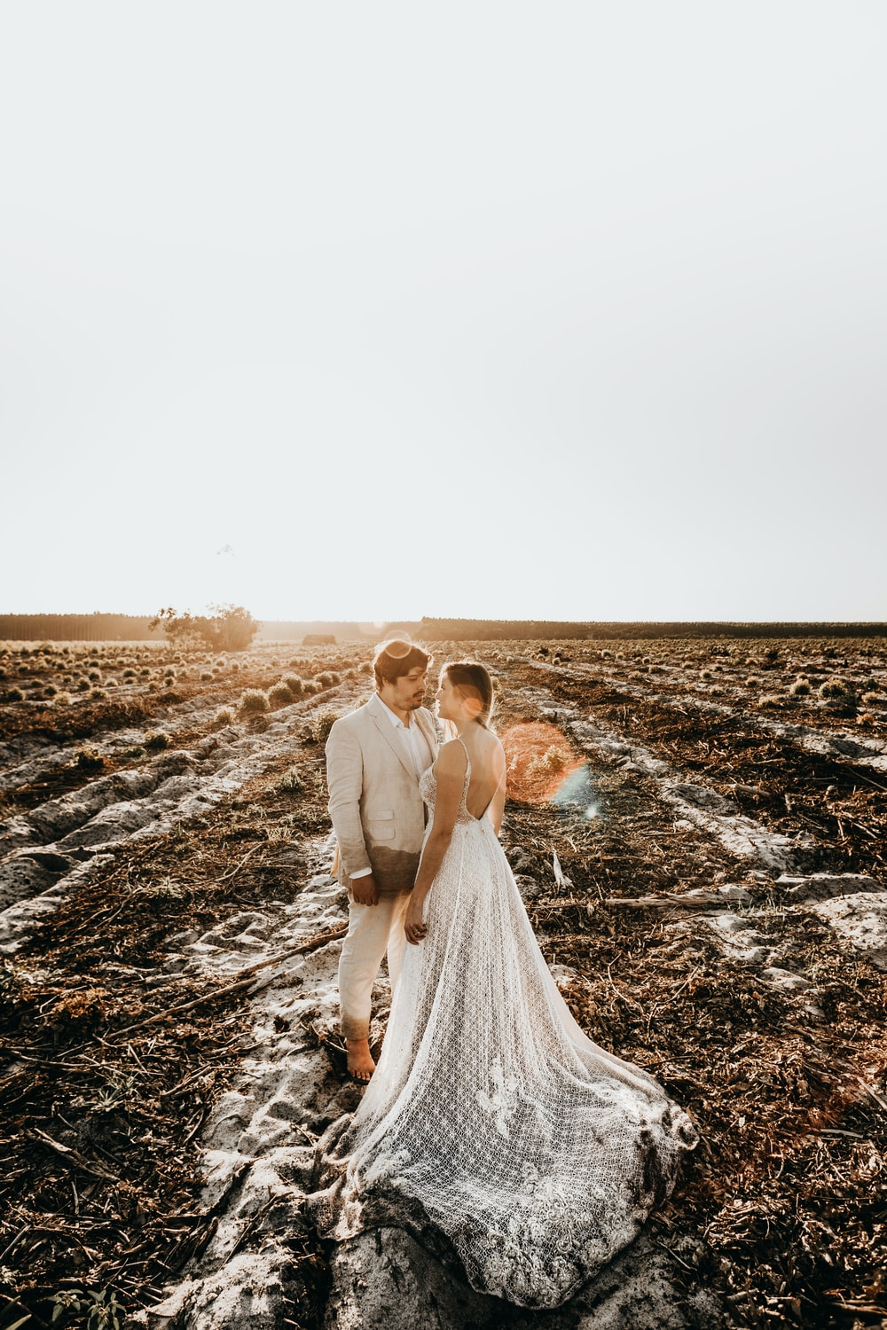 man and woman under white sky
